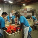 PG&amp;E employees volunteering at the Alameda County Community Food Bank. (cc)  Alameda County Community Food Bank